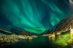 Aurora borealis over Tromso boat docks Royalty Free Stock Images
