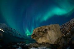 Aurora borealis over Tromso fisheye lens with rock Royalty Free Stock Images