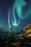 Aurora borealis over Tromso fisheye lens with rock Stock Photos