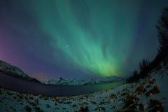 Aurora borealis over Tromso Stock Photo