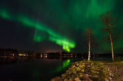 Aurora borealis over water Royalty Free Stock Image