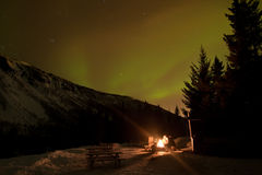 Aurora borealis. People around the campfire and aurora polaris; in Norway Stock Images