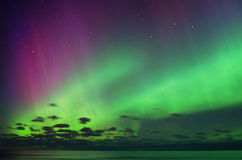 Aurora polar lights and night sky stars stock photography