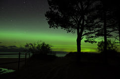 Aurora polar lights and stars over sea Royalty Free Stock Photo