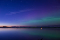 Aurora borealis reflected over a lake Stock Photos