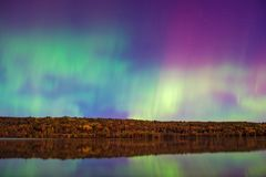 Aurora Borealis reflecting on water surface