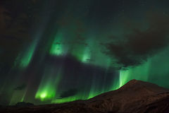 Aurora Borealis Scenery. Aurora Borealis in a circle over mountains Stock Images