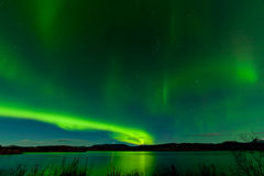 Aurora borealis show Lake Laberge surface mirrored Stock Images