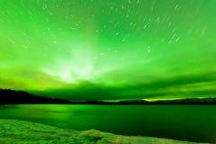 Aurora borealis sky frozen Lake Laberge Yukon Royalty Free Stock Photo