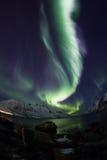 Aurora borealis sopra il fish-eye di Tromso Fotografia Stock