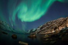 Aurora borealis sopra il fish-eye di Tromso Immagine Stock