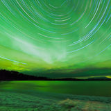 Aurora borealis startrails frozen Lake Laberge Royalty Free Stock Photo