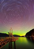 Aurora borealis and startrails at Porteau Cove Royalty Free Stock Images