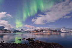Aurora Borealis under Full Moon in Senja Stock Image