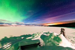 Aurora borealis Whitehorse light pollution Yukon. Spectacular display of Northern Lights or Aurora borealis or polar lights and light pollution from itself not Stock Image