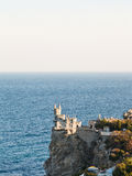 Aurora cliff with Swallow's Nest castle in evening Stock Photo