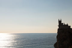 Aurora cliff with Swallow's Nest castle in morning Stock Images