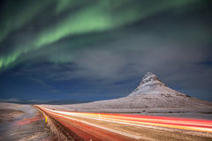 Aurora Drive. The aurora dances over an Icelandic road Stock Photos
