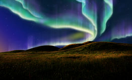 Aurora on field Royalty Free Stock Image