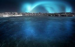 Aurora On The Horizon. Aurora Borealis on the horizon over mountains and water Royalty Free Stock Photography