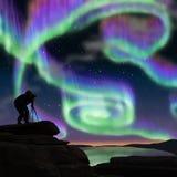 Aurora hunters. Multicolor aurora was shooting by aurora hunter Stock Photo