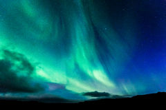 Aurora in Islanda alla notte Fotografia Stock Libera da Diritti