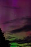 Aurora Light 2. Green aurora peeks over the horizon with a red aurora turning the sky purple Stock Photo