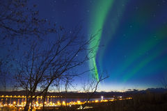 Aurora with the light on the horizon at Kiruna Cityscape, Sweden Royalty Free Stock Photos