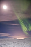 Aurora at the moon. The north light in iceland. (Aurora boreali royalty free stock photos