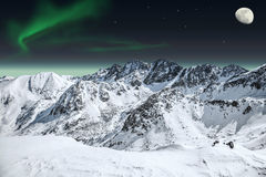 Aurora and moon in mountains. Drawn auroras and the moon in  mountains Stock Photography