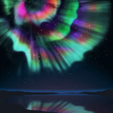 Aurora. Multicolor aurora over lagoon and see the reflection on the water Royalty Free Stock Image