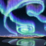 Aurora. Multicolor aurora over lagoon and see the reflection on the water Stock Images