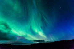 Aurora at night over the land. As a background Stock Image