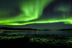 Aurora. Norther Ligts ocean sea  Sky Landscape Star Stars Green Mountian Stock Image