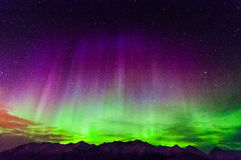Aurora 1. The Northern green and purple Lights over mountains in Alaska Royalty Free Stock Photo