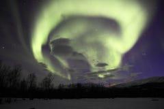 Aurora / Northern Light in Abisko, Sweden. Very beautiful purple, green northern light dancing in the sky. Green tea roll Stock Photo