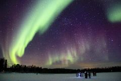 Aurora. Northern light over the frozen lake Stock Photography