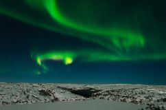 Aurora, northern lights, night, tundra in winter. royalty free stock image