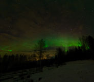 Aurora over city glow Royalty Free Stock Images