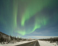 Aurora over Elliot Highway. Winter aurora over Elliot Highway, about 20 miles north of Fairbanks Alaska, under moonlight Royalty Free Stock Image