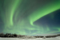 Aurora over Frozen Lake Stock Photography
