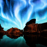 Aurora over lagoon. Multicolor aurora over lagoon and red rock Royalty Free Stock Image