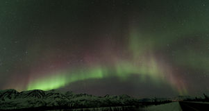 Aurora over mountains. Near Broad pass Stock Photo