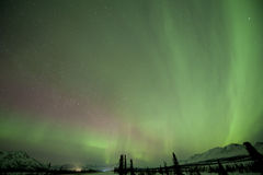 Aurora over mountains. Near Broad pass Royalty Free Stock Photo