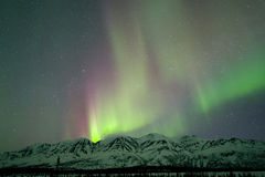 Aurora over mountains. Near Broad pass Royalty Free Stock Image