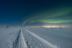 Aurora over road Stock Images