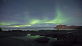 Aurora over the sea at Utakleiv beach, Lofoten Islands, Norway. Aurora over the sea timelapse at Utakleiv beach, Lofoten Islands, Norway stock video