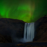 The aurora over Skogafoss of Iceland Stock Image