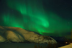 Aurora polaris №2. Aurora polaris above a mountain ridge Stock Photos