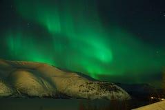 """Aurora polaris â""""–2. Aurora polaris above a mountain ridge stock photos"""